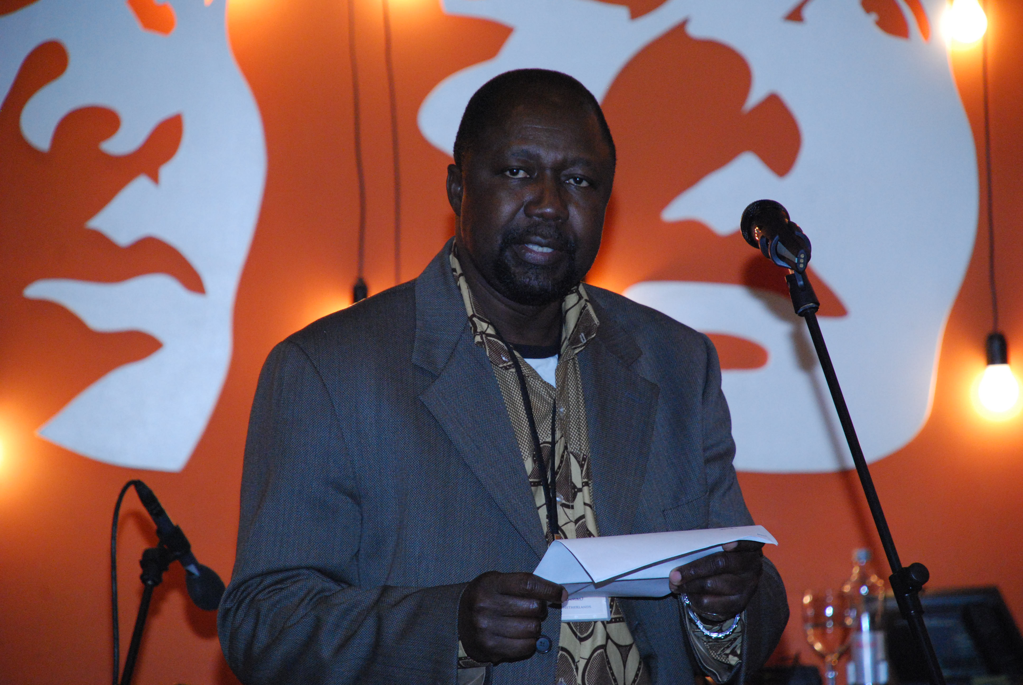 Koulsy Lamko from Chad, Guest Writer in Amsterdam, reading at an event during the General Assembly.