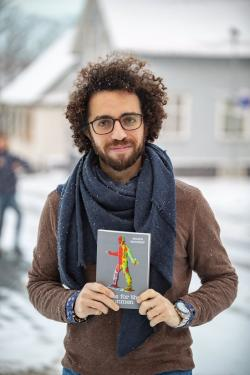 Mazen Maarouf with his short story collection Jokes for the Gunmen. Photo: ©Árni Sæberg. Photo.