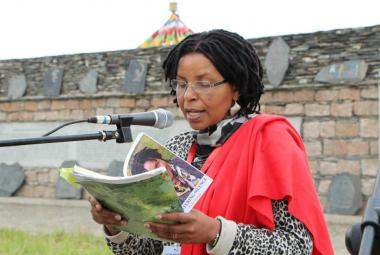 Philo Ikonya reads from her latest novel, Splintering Silence, in Qinghai, China, 2014